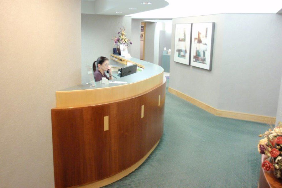 A receptionist at reception area at Mahar Dental