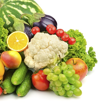 A variety of healthy fruits and vegetables piled together.