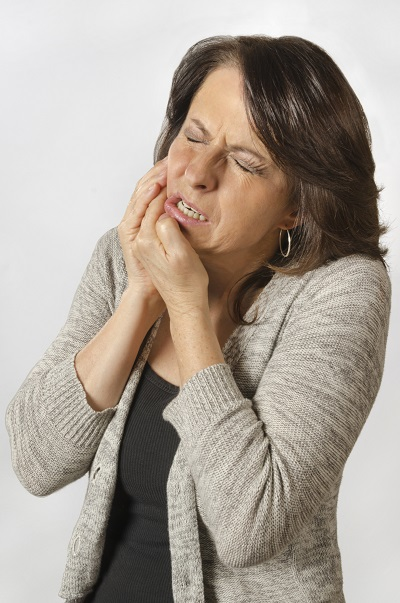 Woman in North Syracuse experiencing TMJ pain